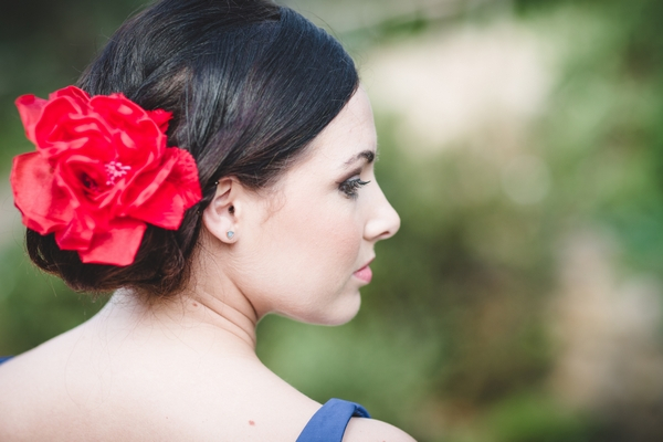 Spanish style bridesmaid with red flower in hair
