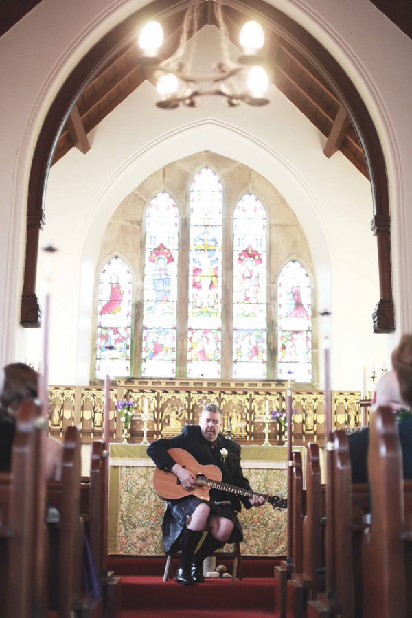 Man playing guitar in church