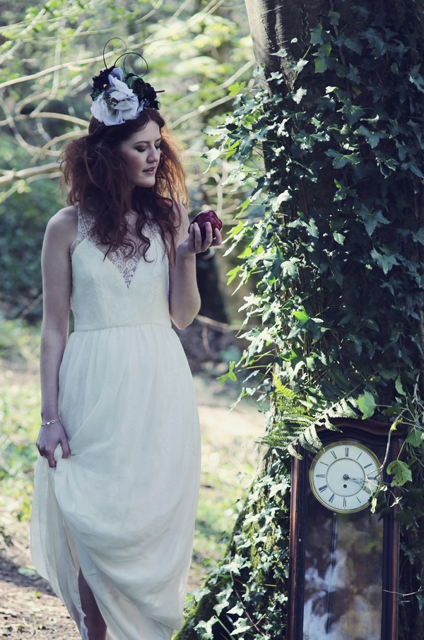 Bride standing next to clock