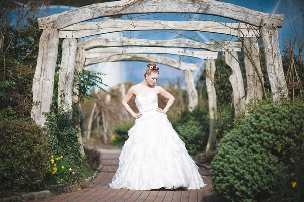 Bride with hands on hips at Eden Project