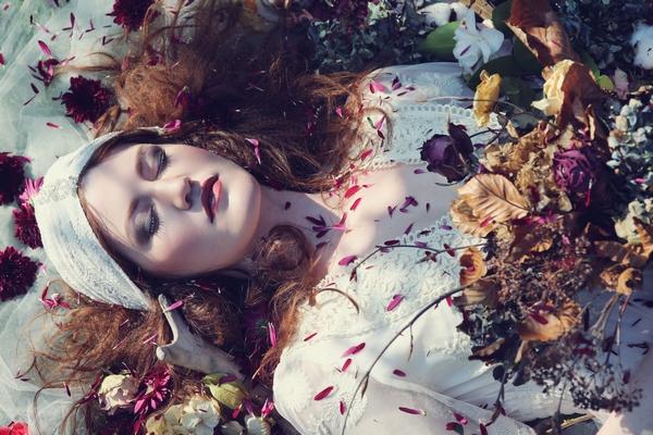Bride laying in petals