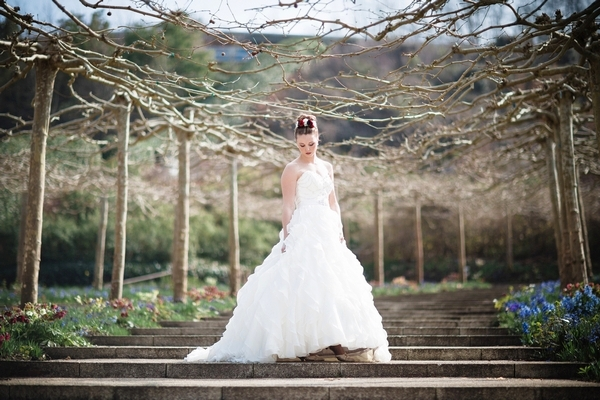 Bride on steps at Eden Project