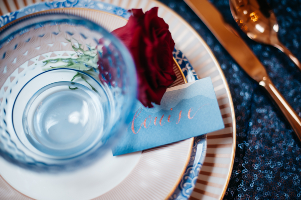 Wedding place setting with blue bowl and blue name tag