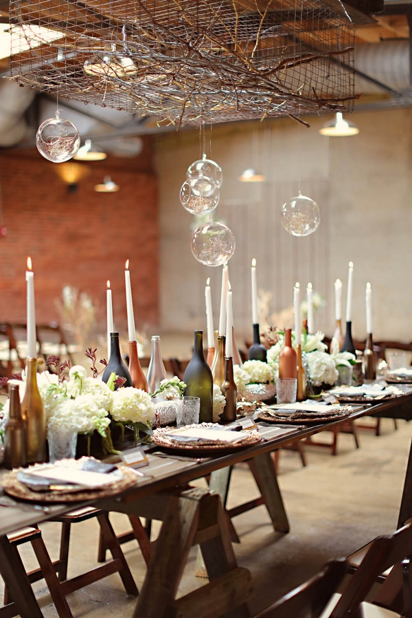 Bottles and candle wedding table decoration