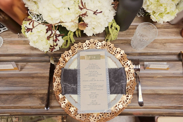 Wedding menu on plate with gold charger