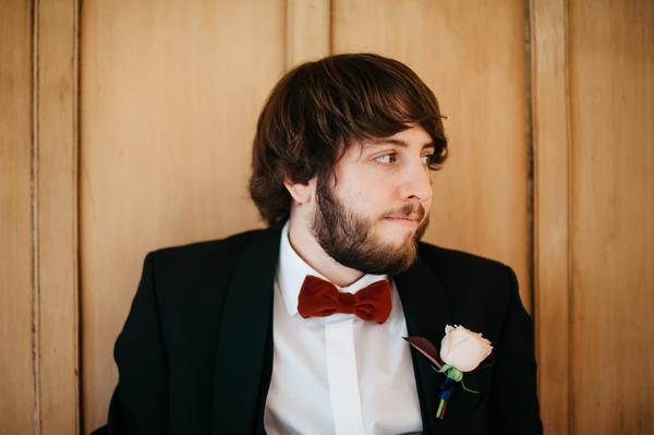Groom wearing red bow tie