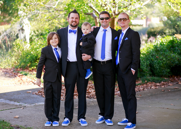 Groomsmen in suits and trainers