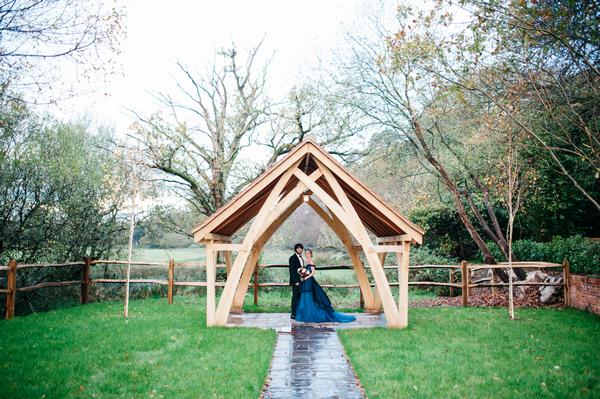 Bride and groom under wooden frame