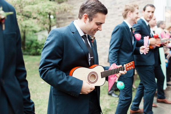 Wedding guest holding ukulele