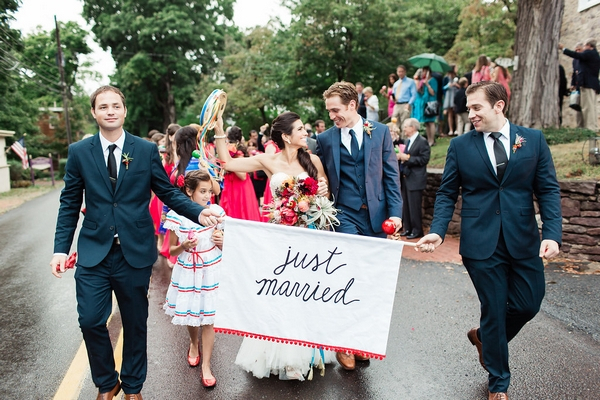 Wedding procession behind Just Married banner