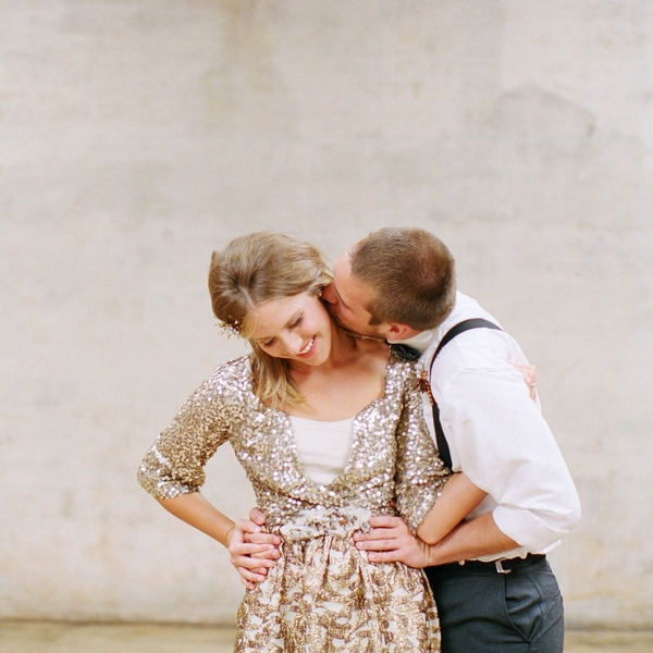 Groom kissing bride's neck