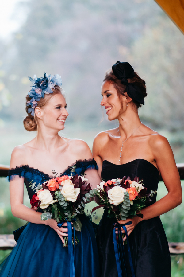 Bride and bridesmaid in blue dresses