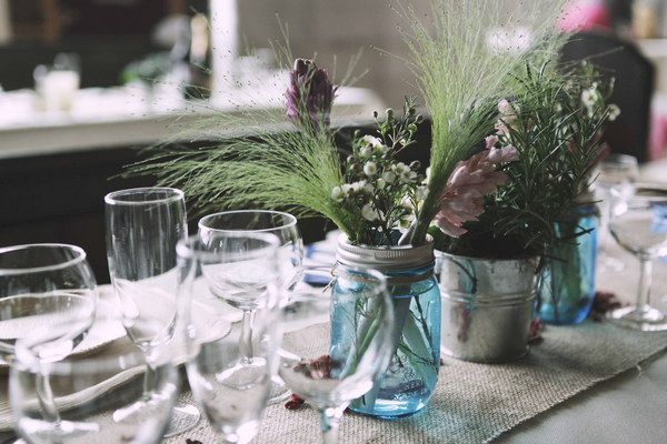 Jar of flowers on wedding table