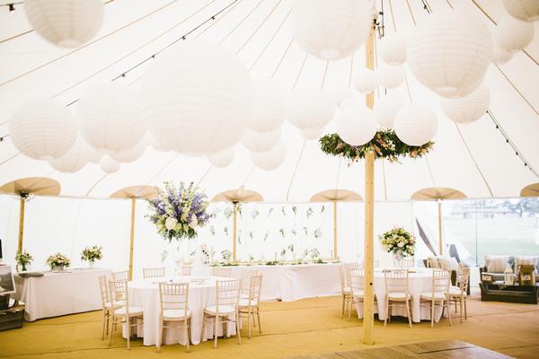 Wedding tables inside PapaKata tent