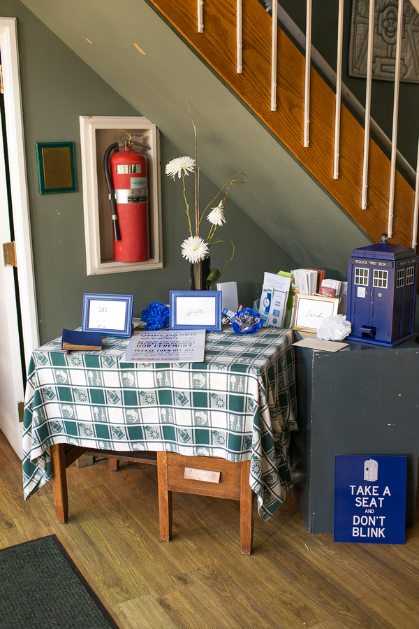 Table with Doctor Who themed wedding items