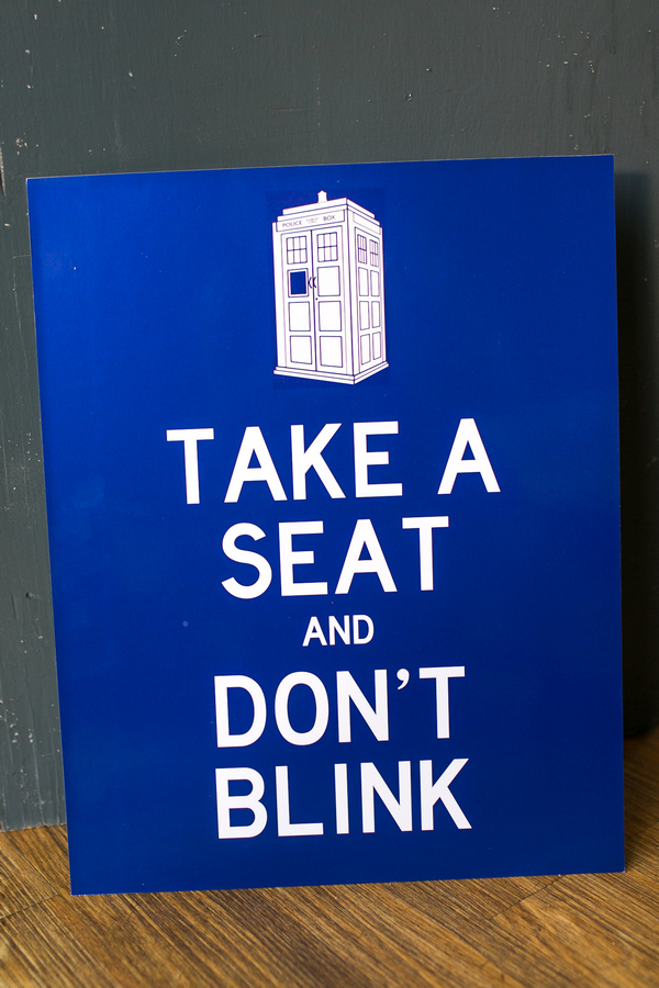 Take a seat and don't blink sign