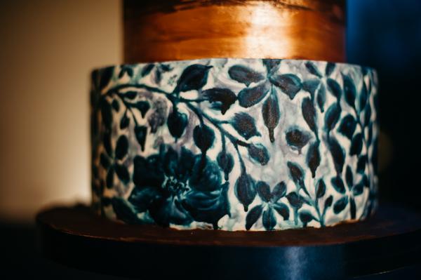 Blue flower detail on wedding cake