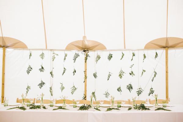 Leaf backdrop behind wedding table