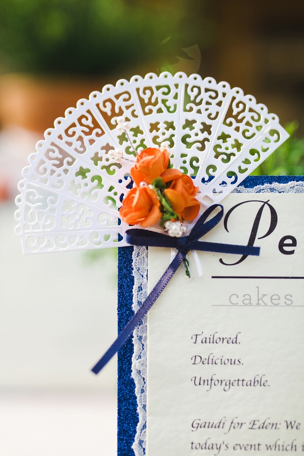 Small fan detail on corner of Spanish wedding stationery