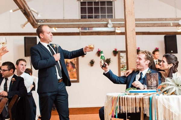 Best man toasting bride and groom