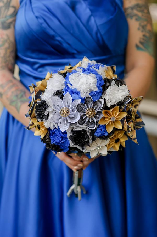 Bride holding handmade paper bouquet
