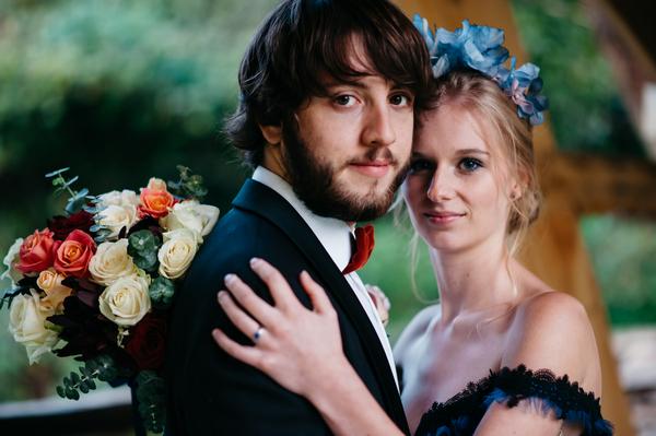 Bride with hand on groom's shoulder