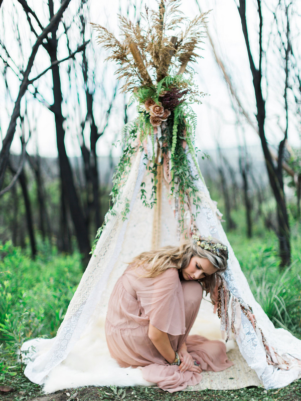 Bohemian bridesmaid crouching