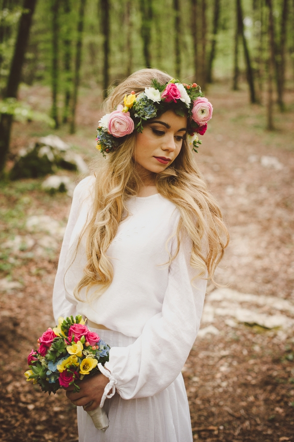 Boho bride with flower crown holding bouquet