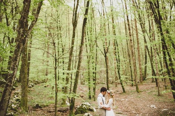 Bride and groom in woods