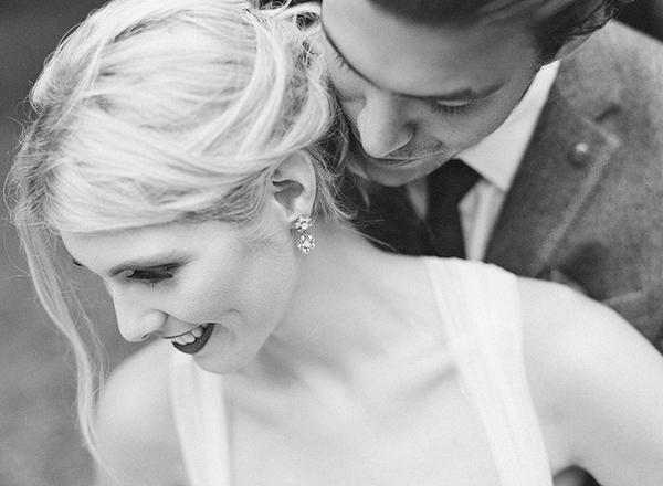 Groom behind bride