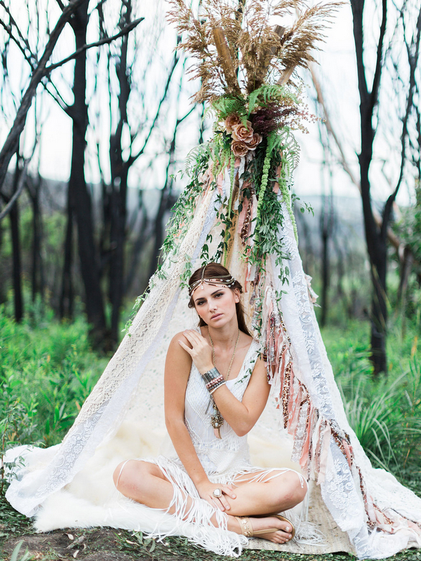 Bohemian bridesmaid in tipi with hand on shoulder