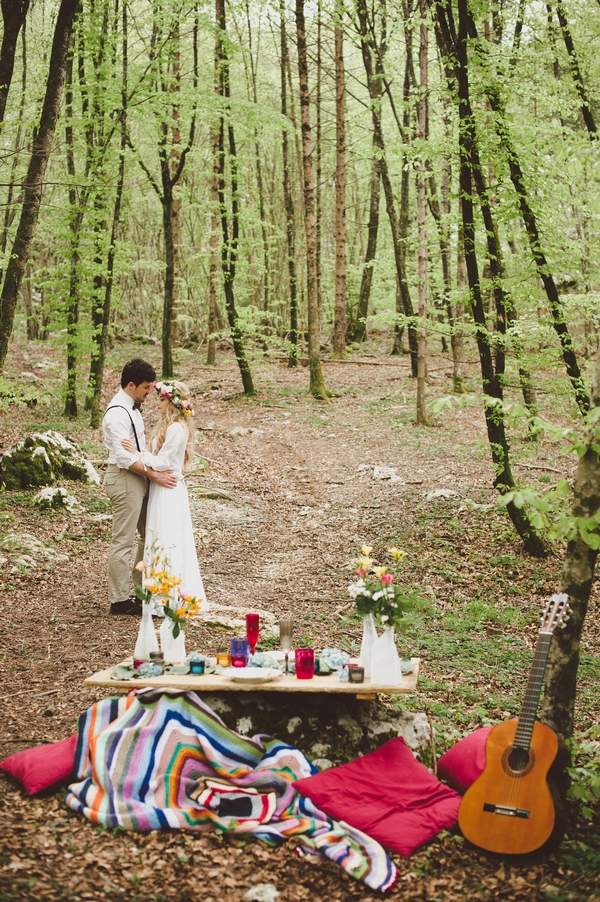 Bride and groom in woods with table