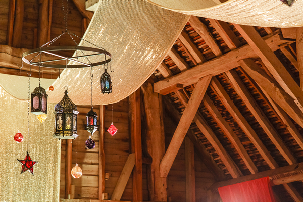 Lanterns hanging from ceiling of Longford Barn