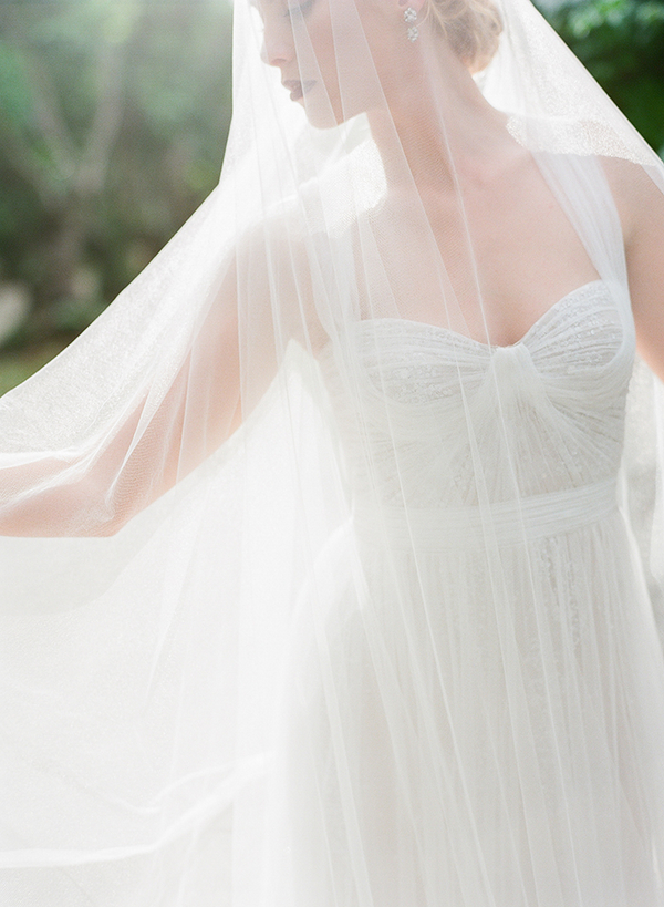 Bride covered in long veil