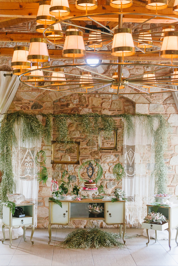 Wedding candy table decorated with ferns and foliage
