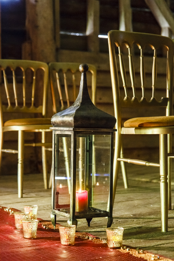 Lantern at end of wedding ceremony chairs