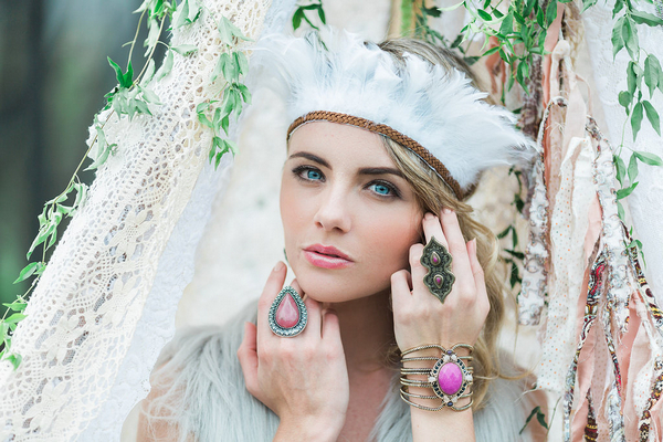 Bohemian bridesmaid with feather headpiece