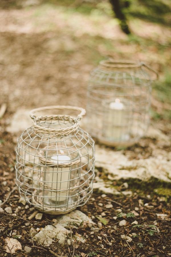 Lanterns on ground in woods