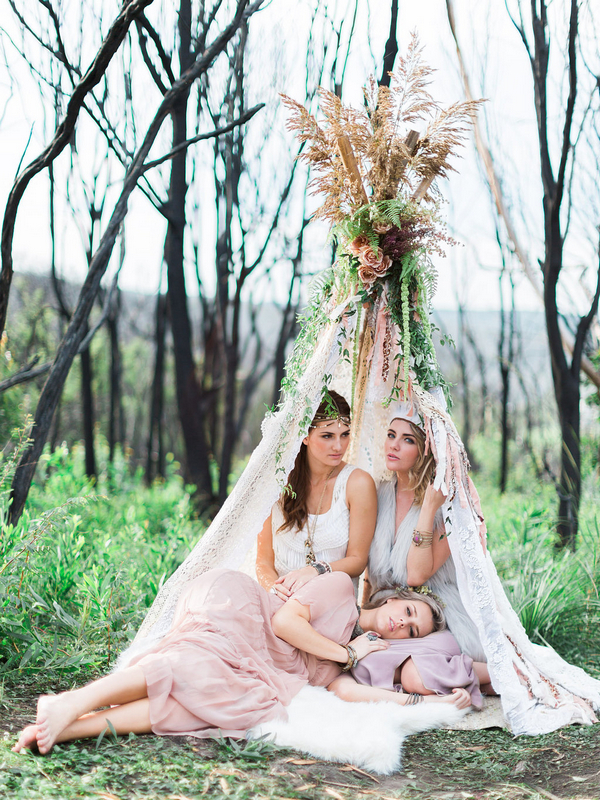 Three bohemian bridesmaids in tipi