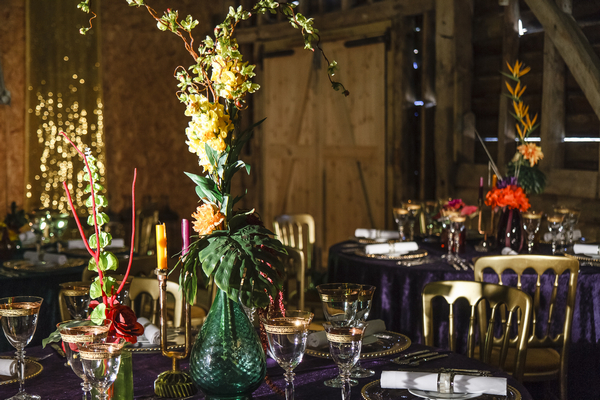 Wedding table with colourful glassware and flowers