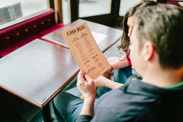 Couple sitting reading drink menu