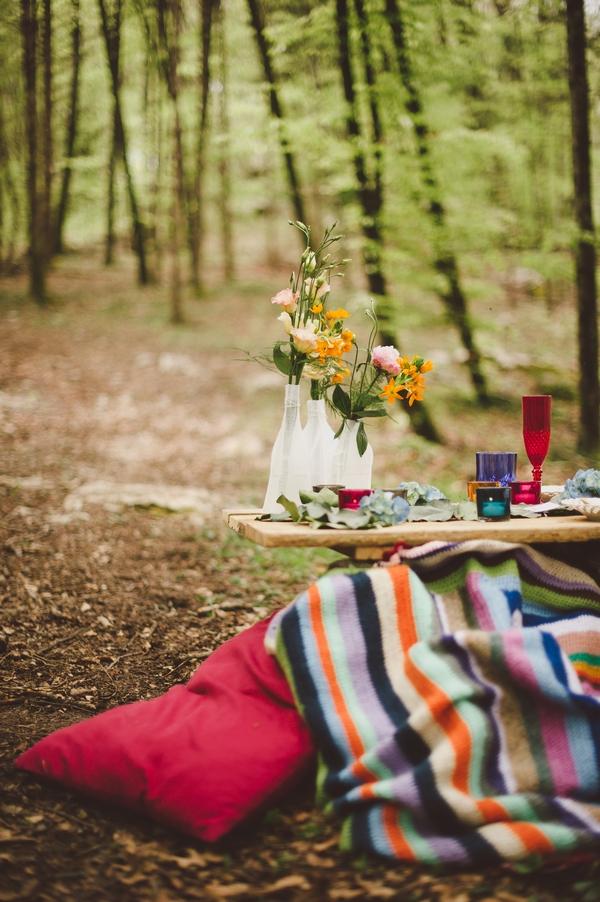 Bottles of flowers in woods