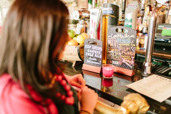Woman standing at bar