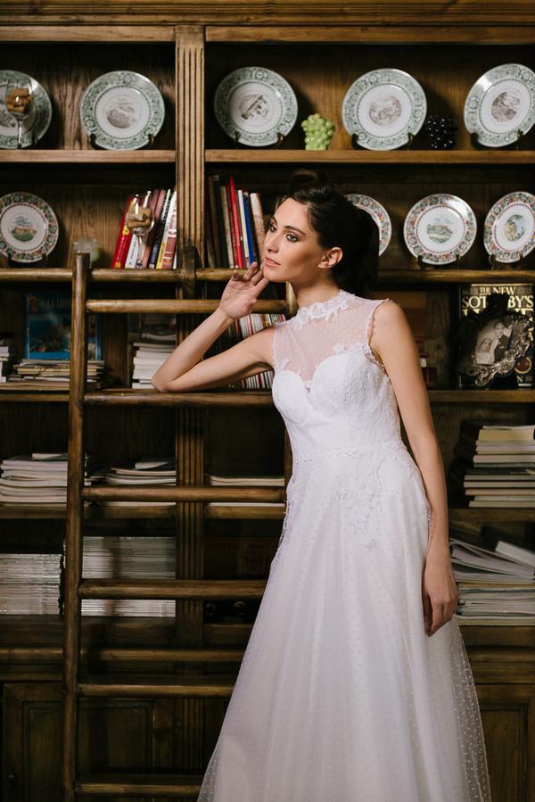 Bride leaning on shelves