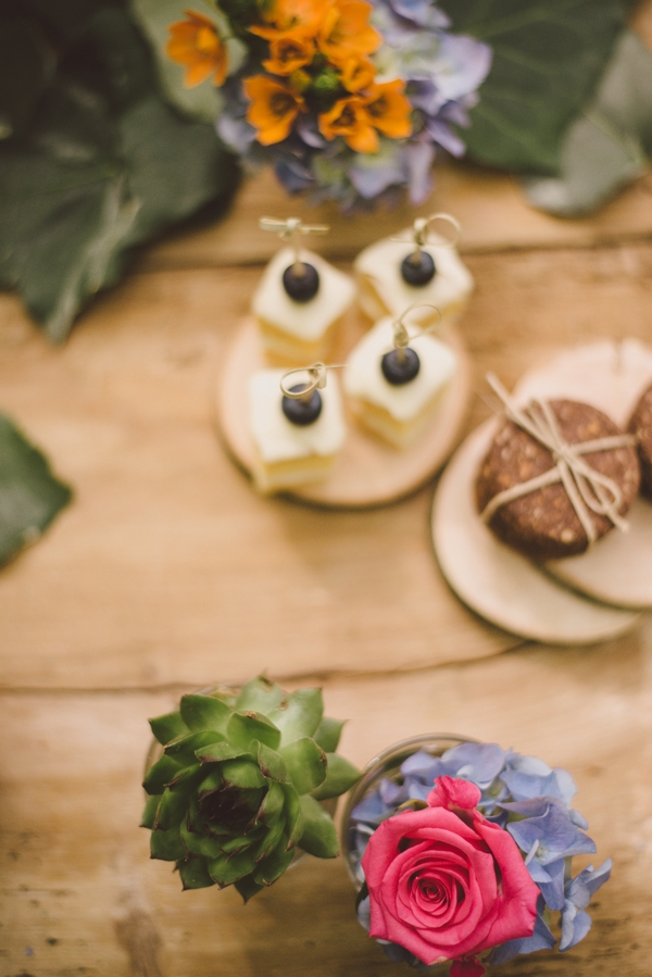 Wedding cakes and flowers on table