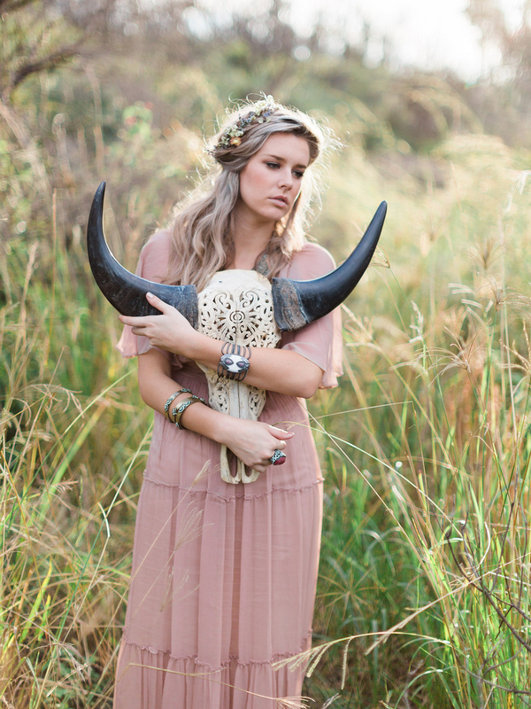 Bohemian bridesmaid holding horned skull