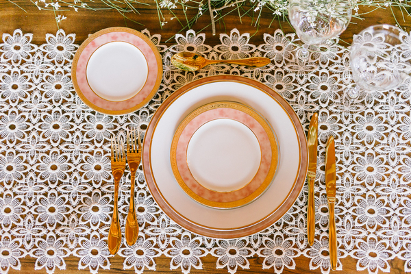 Plates on embroidered table runner