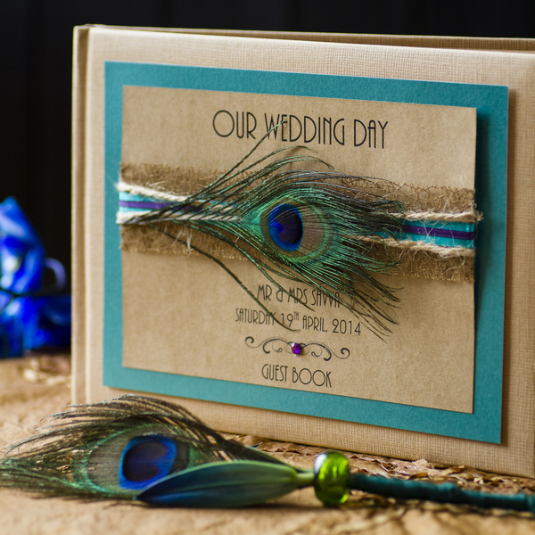 Wedding guest book with peacock feather