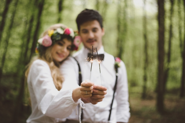 Boho bride and groom with sparklers