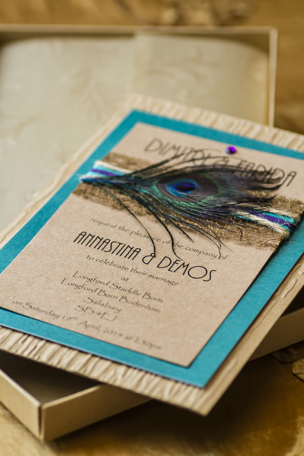 Wedding stationery with peacock feather